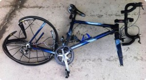damaged bicycle after collision caused by car driver