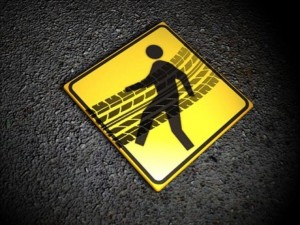 pedestrian hit by car while crossing road