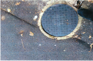 defective manhole cover